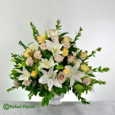 Peach and white flowers for funeral service