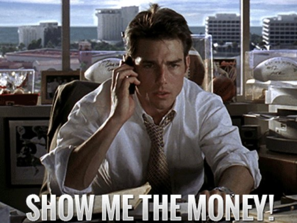 Foto do ator Tom Cruise caracterizado como o personagem Jerry Maguire e o texto ¨Show me the money!¨