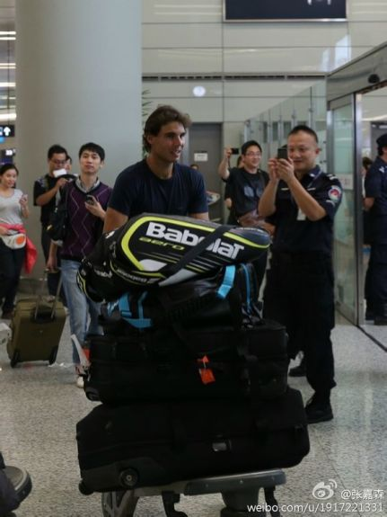 With his trusty travel companion - his Babolat racquet bag