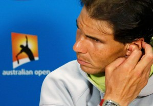 Rafael Nadal of Spain listens to a question during a news conference after being defeated by Tomas Berdych of the Czech Republic in their men's singles quarter-final match at the Australian Open 2015 tennis tournament in Melbourne