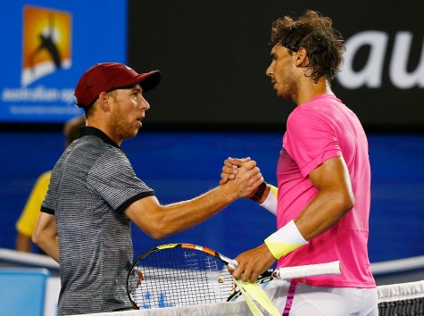 Rafael Nadal (R) of Spain shakes hands with Dudi Sela of Israel after defeating him in their men's singles third round match at the Australian Open 2015 tennis tournament in Melbourne