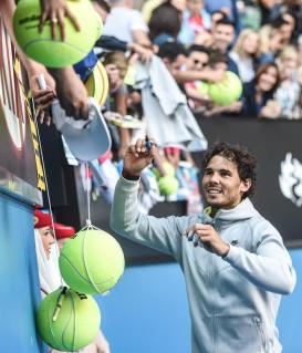 Rafael Nadal signs autographs after his win against Kevin Anderson
