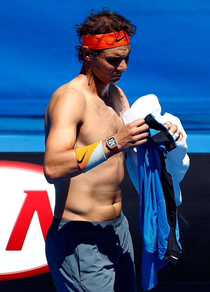 Spain's Rafael Nadal changes his shirt during a practice session on Rod Laver Arena at Melbourne Park