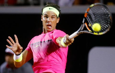 Rafael Nadal of Spain returns to Fabio Fognini of Italy during their men's singles tennis semi-final match at the Rio Open