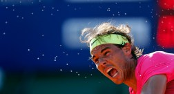 Drops of sweat come off Spain's Rafael Nadal as he serves during his tennis match against Argentina's Carlos Berlocq at the ATP Argentina Open in Buenos Aires, February 28, 2015. REUTERS/Marcos Brindicci (ARGENTINA - Tags: SPORT TENNIS)