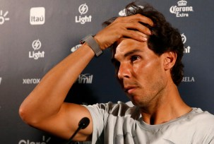 Nadal of Spain reacts during a news conference ahead of the Rio Open 2015 tennis tournament in Rio de Janeiro