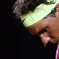 Nadal of Spain prepares to serve to Bellucci of Brazil during their men's singles tennis match at the Rio Open