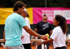Nadal talks to a girl during a tennis clinic in Buenos Aires
