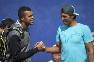 Nadal and Tsonga shake hands during practice session at Barcelona Open