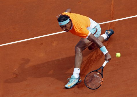 Nadal of Spain returns the ball to Djokovic of Serbia during their semi-final match at the Monte Carlo Masters in Monaco