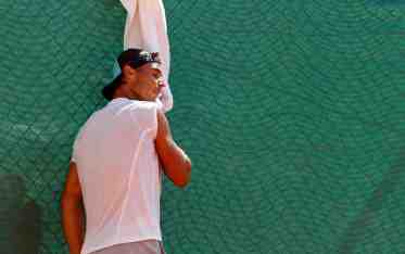 Rafael Nadal of Spain wipes his face as he attends a training session at the Monte Carlo Masters in Monaco