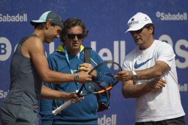 Rafael Nadal talks about his racket with Roig and Uncle Toni during practice in Barcelona