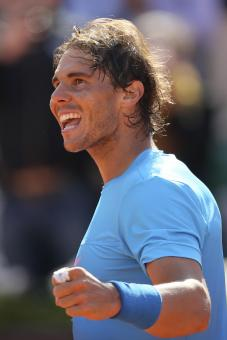 Spain's Rafael Nadal celebrates winning his the third round match of the French Open tennis tournament in three sets 6-1, 6-3, 6-2, against Russia's Andrey Kuznetsov at the Roland Garros stadium, in Paris, France, Saturday, May 30, 2015. (AP Photo/David Vincent)