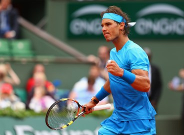 PARIS, FRANCE - MAY 26: Rafael Nadal of Spain celebrates match point in his Men's Singles match against Quentin Halys of France on day three of the 2015 French Open at Roland Garros on May 26, 2015 in Paris, France. (Photo by Clive Brunskill/Getty Images)