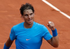 Spain's Rafael Nadal clenches his fist after defeating compatriot Nicolas Almagro during their second round match of the French Open tennis tournament at the Roland Garros stadium, Thursday, May 28, 2015 in Paris, (AP Photo/Christophe Ena)
