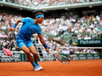 Rafael Nadal of Spain plays a shot to Quentin Halys of France during their men's singles match at the French Open tennis tournament at the Roland Garros stadium in Paris, France, May 26, 2015. REUTERS/Jean-Paul Pelissier