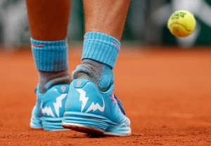 A close-up shows the shoes of Rafael Nadal of Spain during his men's singles match against Quentin Halys of France at the French Open tennis tournament at the Roland Garros stadium in Paris, France, May 26, 2015. REUTERS/Jean-Paul Pelissier
