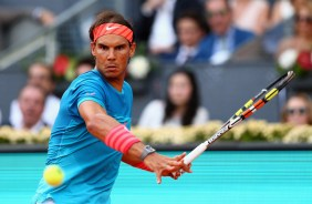 Rafael Nadal of Spain plays a forehand against Andy Murray of Great Britain in the mens final during day nine of the Mutua Madrid Open tennis tournament at the Caja Magica on May 10, 2015 in Madrid, Spain. (May 9, 2015 - Source: Clive Brunskill/Getty Images Europe)