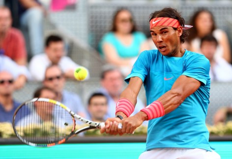 Rafael Nadal of Spain plays a backhand against Andy Murray of Great Britain in the mens final during day nine of the Mutua Madrid Open tennis tournament at the Caja Magica on May 10, 2015 in Madrid, Spain. (May 9, 2015 - Source: Clive Brunskill/Getty Images Europe)