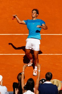 MADRID, SPAIN - MAY 09: Rafael Nadal of Spain celebrates defeating Tomas Berdych of Czech Republic in the semi finals during day eight of the Mutua Madrid Open tennis tournament at the Caja Magica on May 9, 2015 in Madrid, Spain. (Photo by Julian Finney/Getty Images)