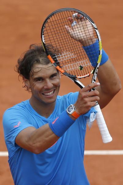 Spain's Rafael Nadal celebrates winning the first round match of the French Open tennis tournament against Quentin Halys of France at the Roland Garros stadium, in Paris, France, Tuesday, May 26, 2015. Nadal won in three sets 6-3, 6-3, 6-4. (AP Photo/Michel Euler)