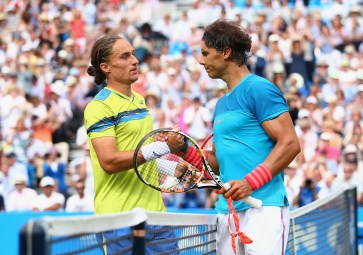 LONDON, ENGLAND - JUNE 16: Alexandr Dolgopolov (L) of Ukraine shakes hands with Rafael Nadal of Spain after their men's singles first round match against during day two of the Aegon Championships at Queen's Club on June 16, 2015 in London, England. (Photo by Clive Brunskill/Getty Images)