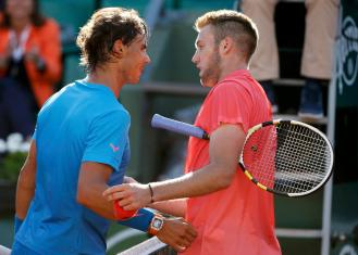 Rafael Nadal of Spain shakes hands with Jack Sock of the U.S. after winning their men's singles match during the French Open tennis tournament at the Roland Garros stadium in Paris, France, June 1, 2015. REUTERS/Vincent Kessler