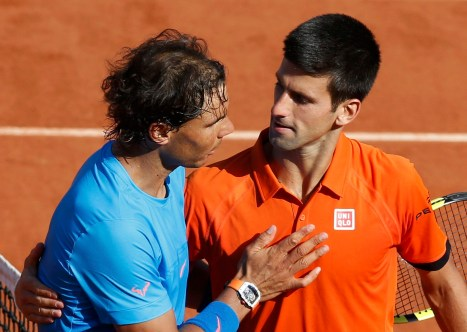 Novak Djokovic of Serbia (R) shakes hands with Rafael Nadal of Spain after winning their men's quarter-final match during the French Open tennis tournament at the Roland Garros stadium in Paris, France, June 3, 2015. REUTERS/Jean-Paul Pelissier