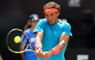 STUTTGART, GERMANY - JUNE 12: Rafael Nadal of Spain retuns during his match against Bernard Tomic of Australia on day seven of Mercedes Cup 2015 on June 12, 2015 in Stuttgart, Germany. (Photo by Daniel Kopatsch/Bongarts/Getty Images)