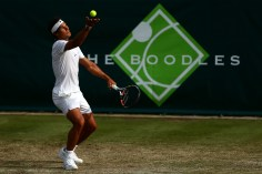STOKE POGES, ENGLAND - JUNE 26: Rafael Nadal of Spain serves during his match against Robin Haase of the Netherlands during Day 4 of The Boodles Tennis Event at Stoke Park on June 26, 2015 in Stoke Poges, England. (Photo by Jordan Mansfield/Getty Images)