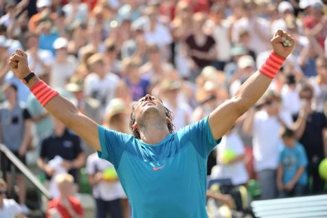Spain's Rafael Nadal celebrates after defeating Sebia's Viktor Troicki in the final of the Mercedes Cup ATP tennis tournament in Stuttgart, Germany, Sunday June 14, 2015. ( Marijan Murat/dpa via AP)