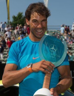Rafael Nadal of Spain poses with his trophy after winning the final match against Viktor Troicki of Serbia at the Mercedes Cup ATP tennis tournament in Stuttgart, Germany, Sunday June 14, 2015. (Marijan Murat/dpa, via AP)