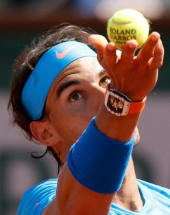 Rafael Nadal of Spain serves to Novak Djokovic of Serbia during their men's quarter-final match during the French Open tennis tournament at the Roland Garros stadium in Paris, France, June 3, 2015. REUTERS/Jean-Paul Pelissier
