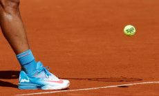 A ball and the shoes of Rafael Nadal of Spain are pictured as he prepares to serve to Novak Djokovic of Serbia during their men's quarter-final match during the French Open tennis tournament at the Roland Garros stadium in Paris, France, June 3, 2015. REUTERS/Jean-Paul Pelissier