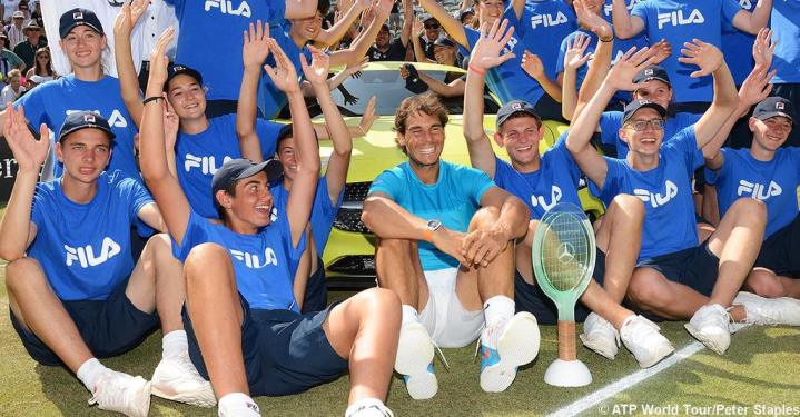 Rafael Nadal poses with ball kids after winning Mercedes Cup in Stuttgart