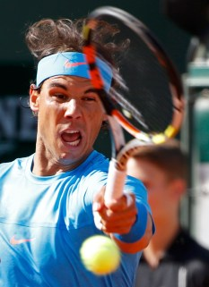 Rafael Nadal of Spain returns the ball to Jack Sock of the U.S. during their men's singles match during the French Open tennis tournament at the Roland Garros stadium in Paris, France, June 1, 2015. REUTERS/Vincent Kessler
