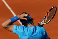 Rafael Nadal of Spain adjusts his headband during his men's singles match against Jack Sock of the U.S. during the French Open tennis tournament at the Roland Garros stadium in Paris, France, June 1, 2015. REUTERS/Jean-Paul Pelissier