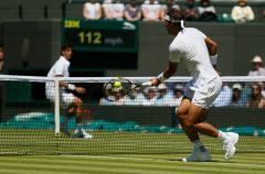 Rafael Nadal of Spain hits a volley during his match against Thomaz Bellucci of Brazil at the Wimbledon Tennis Championships in London, June 30, 2015. REUTERS/Stefan Wermuth