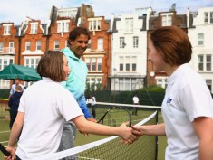 Fourteen-time Grand Slam champion Rafael Nadal today gave 14 lucky school children from the Oasis South Bank Academy in Waterloo, the surprise of their life when he jumped on court to help coach a session at The Aegon Championships in Queen's Club, London to mark the 20,000th school supported by British Tennis on day one of the Aegon Championships at Queen's Club on June 15, 2015 in London, England. (June 14, 2015 - Source: Jordan Mansfield/Getty Images Europe)