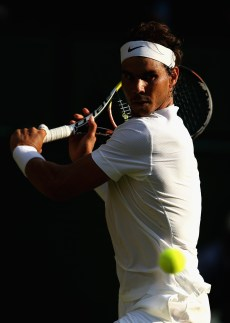 LONDON, ENGLAND - JULY 02: Rafael Nadal of Spain plays a backhand in his Gentlemens Singles Second Round match against Dustin Brown of Germany during day four of the Wimbledon Lawn Tennis Championships at the All England Lawn Tennis and Croquet Club on July 2, 2015 in London, England. (Photo by Ian Walton/Getty Images)