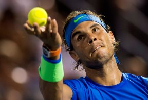 Rafael Nadal, of Spain, tosses the ball to serve to Kei Nishikori, of Japan, during the quarterfinals of the Rogers Cup tennis tournament Friday, Aug. 14, 2015, in Montreal. (Paul Chiasson/The Canadian Press via AP)
