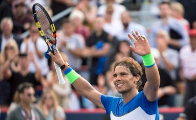Rafael Nadal, of Spain, salutes the crowd following his win over Sergiy Stakhovsky, of Ukraine, in the Rogers Cup men's tennis tournament, Wednesday, Aug. 12, 2015, in Montreal. (Paul Chiasson/The Canadian Press via AP) MANDATORY CREDIT