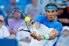 Rafael Nadal, of Spain, serves to Feliciano Lopez, of Spain, during a match at the Western & Southern Open tennis tournament, Thursday, Aug. 20, 2015, in Mason, Ohio. (AP Photo/John Minchillo)