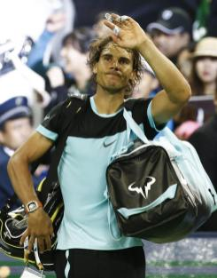 Rafael Nadal of Spain waves after his semi-final match against Jo-Wilfried Tsonga of France in the Shanghai Tennis Masters at the Qi Zhong Tennis Center in Shanghai, China, 17 October 2015. (España, Tenis, Francia) EFE/EPA/ROLEX DELA PENA