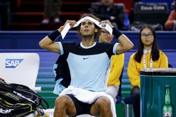 Rafael Nadal of Spain changes headband in between games against Jo-Wilfried Tsonga of France in their men's singles semi-final match at the Shanghai Masters tennis tournament in Shanghai, China, October 17, 2015. REUTERS/Damir Sagolj