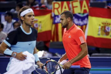 Jo-Wilfried Tsonga of France and Rafael Nadal (L) of Spain change sides in their men's singles semi-final match at the Shanghai Masters tennis tournament in Shanghai, China, October 17, 2015. REUTERS/Damir Sagolj