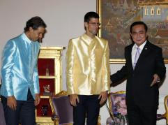 Thai Prime Minister Prayuth Chan-ocha, right, greets tennis players Novak Djokovic, center, of Serbia and Rafael Nadal of Spain at Government House in Bangkok, Thailand Friday, Oct. 2, 2015. Djokovic will face Nadal in the tennis exhibition match in Bangkok to boost confidence in Thailand's safety after a deadly Aug. 17 bombing that left 20 dead in the heart of the capital. (Rungroj Yongrit/Pool Photo via AP)
