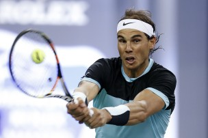 SHANGHAI, CHINA - OCTOBER 14: Rafael Nadal of Spain returns a shot against Ivo Karlovic of Croatia during the men's singles second round match on day 4 of Shanghai Rolex Masters at Qi Zhong Tennis Centre on October 14, 2015 in Shanghai, China. (Photo by Lintao Zhang/Getty Images)