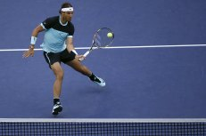 Rafael Nadal of Spain returns a shot to Jo-Wilfried Tsonga of France during their men's singles semi-final match at the Shanghai Masters tennis tournament in Shanghai, China, October 17, 2015. REUTERS/Aly Song