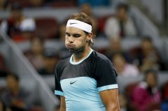 Rafa Nadal of Spain reacts after losing a point to Novak Djokovic of Serbia during the men's singles final match at the China Open Tennis Tournament in Beijing, China, October 11, 2015. REUTERS/Kim Kyung-Hoon